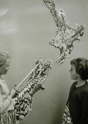 Slide, Two Students with Map