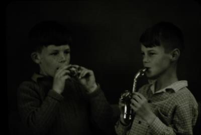 Slide, Two Children Playing Instruments
