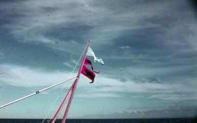 Slide, Flags on boat